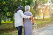 canvas print picture - Help and care Asian senior or elderly old lady woman use walker with strong health while walking at park in happy fresh holiday.