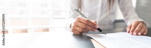 Business woman signing contract, making a deal.