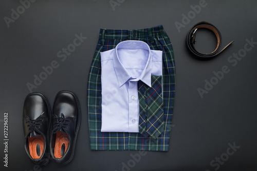 Fényképezés  School uniform for boy on black background