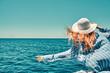 Cruise ship vacation woman enjoying travel vacation at sea. Free carefree happy girl travel at ocean or sea. Woman on a yacht enjoying the beautiful vacation.