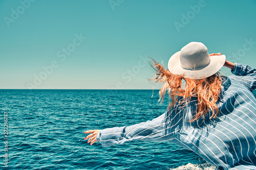 Fototapeta Cruise ship vacation woman enjoying travel vacation at sea