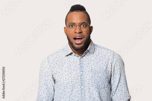 Headshot portrait african man gawp look at camera feels surprised Canvas Print