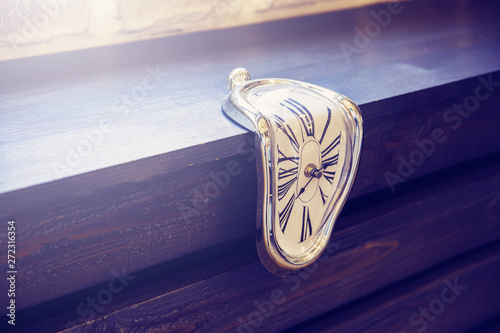 Canvastavla  Indoor clocks of unusual shape on a brown wooden background