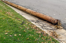 Downed Utility Pole Lying On R...
