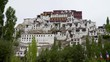 Smooth tilt down shot of the Thiksey Tibetan-style monastery in Ladakh, India in the Indus valley. Sacred Buddhist place in the Himalayas.