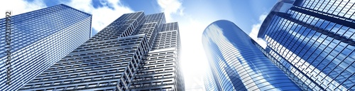 Obraz Beautiful skyscrapers against the sky, panorama of modern high-rise buildings, 3d rendering - fototapety do salonu