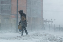 The Blizzard, Strong Wind, Sleet, Blurred Silhouette Of The Girl Tries To Take Cover From Bad Weather, Overcomes All Burdens Of Severe Climate