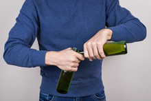 Cropped Close-up Photo Of Skilled Party Goer Showing His Talant In Opening Bottles Isolated Grey Background