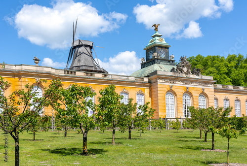 New Chambers (Neue Kammern) palace and Windmill (Windmuhle) in  Sanssouci park in spring, Potsdam, Germany