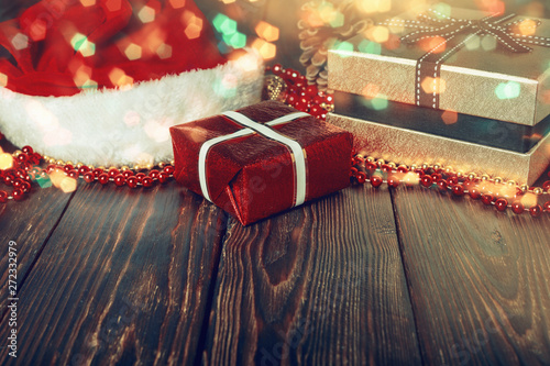 Aluminium Prints Theater Gift boxes with beads, toys and Santa Claus hat on bright glowing background