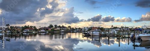 Boats docked at a Marina near Venetian Bay in Naples, Florida