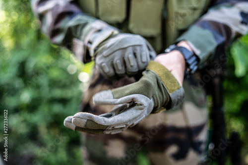 Fotomural Special police military soldier putting battle gloves on for the mission action