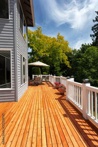 Fototapeta Brand new red cedar outdoor wooden patio during nice weather obraz na płótnie