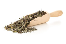 Dried, Raw White Tea Leaves In Wooden Scoop Over White Background