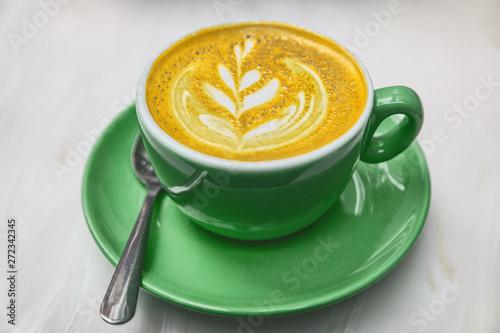 Ayurvedic turmeric latte coffee cup Tableau sur Toile
