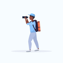 Tourist Hiker With Backpack Looking Through Binoculars Hiking Concept African American Traveler On Hike Full Length Flat White Background