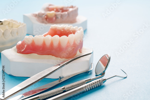 Photo  Close up , Complete denture or full denture on blue background.