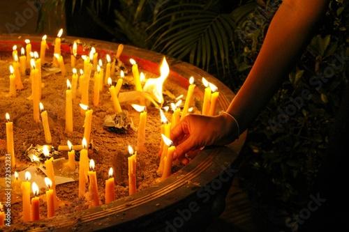 Fotografie, Obraz  Many candles illuminate in the dark, filmed as blurred