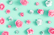 canvas print picture Flowers composition. Pattern made of rose flowers on mint background. Flat lay, top view