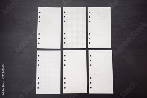 Fototapeta Different paper for notepad mocap on a black wooden background obraz na płótnie