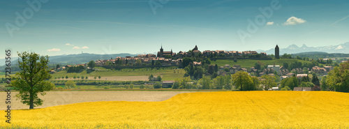 panorama view of the village of Romont in Switzerland with the Alps in the background