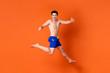 Leinwandbild Motiv Ecstatic smiling shirtless handsome man jumping with hands thumb up