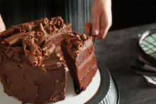 Woman With Tasty Chocolate Cake At Table, Closeup