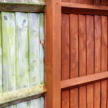 Painting Old Wooden Fence With A Brown Paint, Renovation Concept, Before And After Image