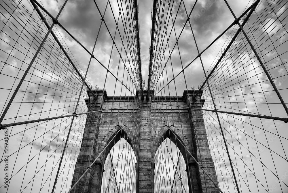 Fototapety, obrazy: Brooklyn Bridge New York City close up architectural detail in timeless black and white under soft overcast skies
