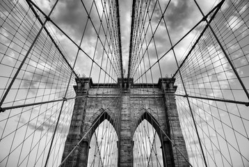 Fototapeta Architektura Brooklyn Bridge New York City close up architectural detail in timeless black and white under soft overcast skies