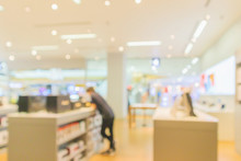 Mobile Phone In Electronic Store Interior With Customer Abstract Blurred Background