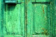 Leinwanddruck Bild - background of green wooden old vintage door close-up
