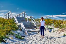 Access Trail To Crane Beach, Ipswich, Massachusetts, USA. Woman Walking To The Beach.