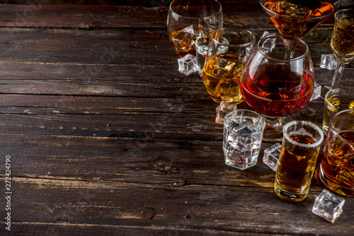 Papel de parede Assortment various hard and strong alcoholic drinks in different glasses: vodka, cognac, tequila, brandy and whiskey, grappa, liqueur, vermouth, tincture, rum, etc