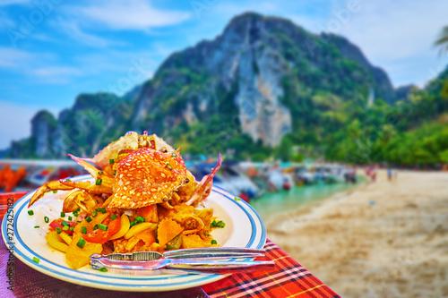Foto auf Leinwand Honig Blue swimmer crabs with vegetables, Phi Phi Don Island, Krabi, Thailand