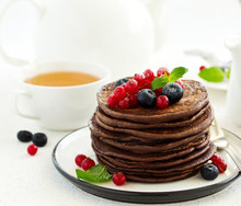Chocolate Pancakes With Berries.