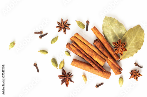Fototapeta Healthy food concept Mix of organic spices star anise, cinnamon, bay and cardamom pods on white background obraz