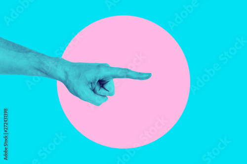 Isolated on blue background painted man hand photo on pink circle. Surrealist...