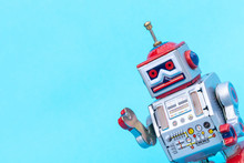 Antique Tin Toy Robot On Blue Background. Vintage And Classic Concept Free Copy Space For Text.