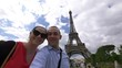 Couple taking selfie with a view of Eiffel Tower in Paris in 4k slow motion 60fps