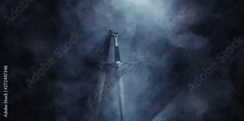 mysterious and magical photo of silver sword over gothic black background with smoke Fototapet