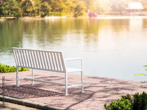 obraz PCV White bench on summer park garden