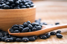Raw Black Beans In Wooden Bowl...