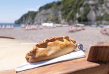 Cornish Pasty On Beach Location