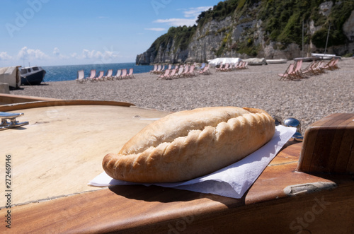 Cornish pasty on boat , beach location in West Country in summer with deck chair Wallpaper Mural