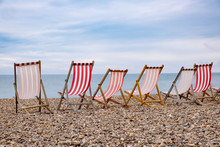Deckchairs On Beach At English Seaside