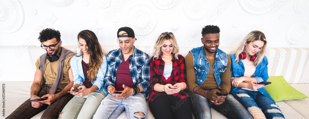 Fototapety, obrazy: Friends using smartphone on sofa at indoor venue - People group addicted by mobile smart phone - Technology concept with always connected millennials sharing content online - Bright vivid filter