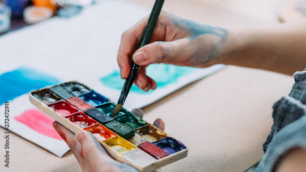 Fototapety, obrazy: Talent and creativity. Cropped shot of female artist painting abstract artwork with watercolor.