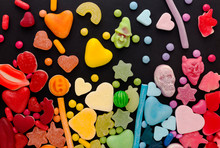Assortment Of Candy Ordered In Rainbow Colors