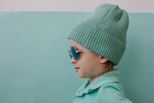 Profile Portrait Of Fashionable Boy Wearing Beanie And Sun Glasses
